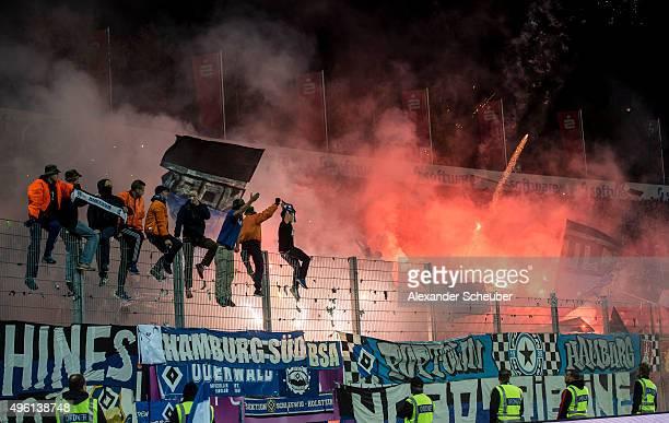 Fans of Hamburger SV set off flares during the first bundesliga match between SV Darmstadt 98 and Hamburger SV at MerckStadion am Boellenfalltor on...