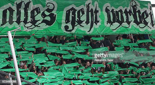 Fans of Hannover 96 hold up a banner reading 'everything passes by' before the Bundesliga match between FC Ingolstadt and Hannover 96 at Audi...