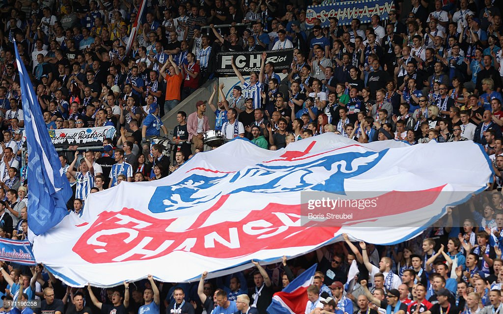 Fans of Hansa Rostock celebrate during the A Juniors Bundesliga final match between FC Hansa Rostock and VfL Wolfsburg at DKBArena on June 23 2013 in...