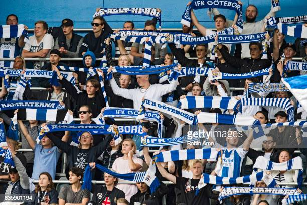 Fans of IFK Goteborg hold up scarfs before the Allsvenskan match between IFK Goteborg and BK Hacken at Gamla Ullevi on August 20 2017 in Gothenburg...