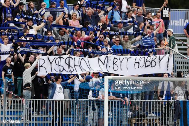 Fans of IK Sirius FK with a sign during the Allsvenskan match between IK Sirius FK and Athletic FC Eskilstuna at Studenternas IP on July 8 2017 in...