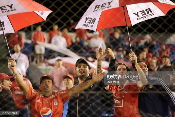 Fans of Independiente cheer for their team during a first leg match between Libertad and Independiente as part of the semifinals of Copa CONMEBOL...
