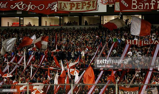Fans of Independiente cheer for their team during a second leg match between Independiente and Arsenal FC as part of second round of Copa...