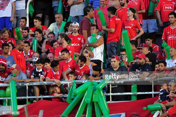 Fans of Independiente display green ballons in memory of the victims of Chapecoense soccer team during a match between Independiente and River Plate...