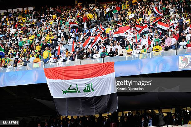 Fans of Iraq follow the action between South Africa and Iraq during the opening match of the FIFA Confederations Cup between South Africa and Iraq at...