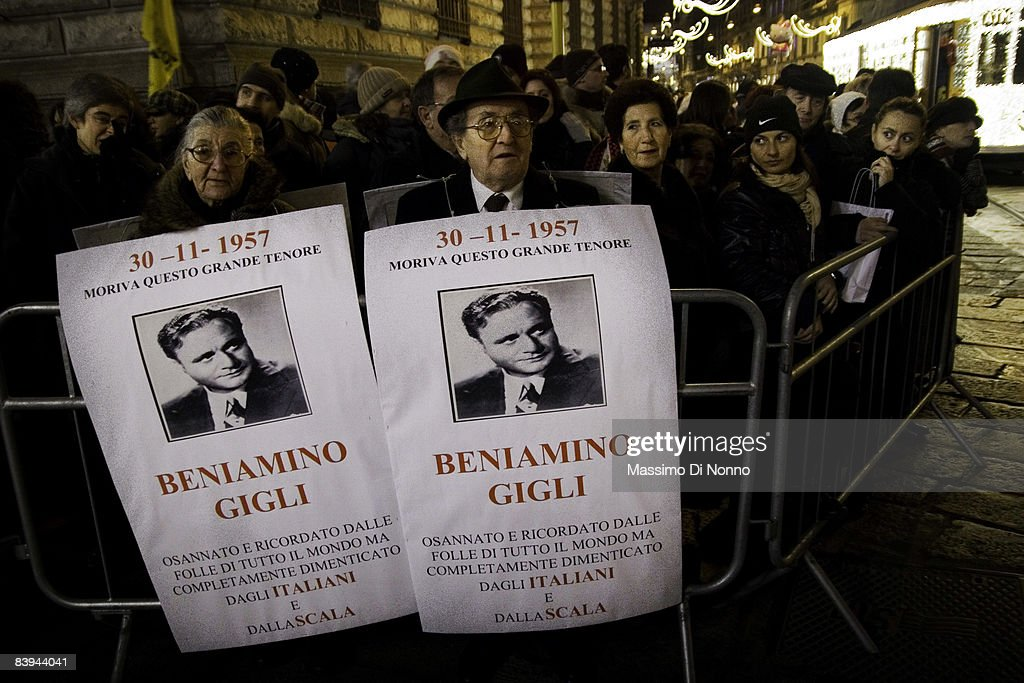 Fans of Italian opera tenor Beniamino Gigle hold his portrait outside the Teatro Alla Scala as it begins its 2008/2009 season on December 7, 2008 in Milan, Italy.
