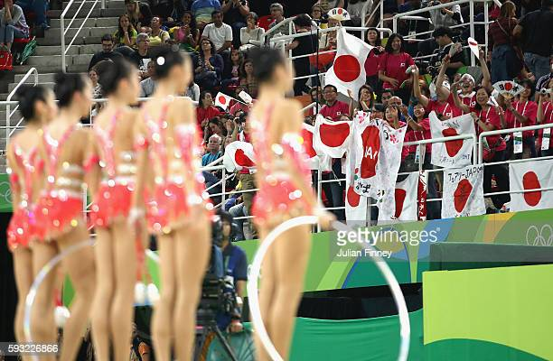 Fans of Japan cheer on Airi Hatakeyama Rie Matsubara Sakura Noshitani Sayuri Sugimoto and Kiko Yokota of Japan during the Group AllAround Final on...