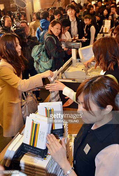 Fans of Japanese author Haruki Murakami buy his newly published book 'Colourless Tsukuru Tazaki and the Year of his Pilgrimage' at the Tsutaya book...
