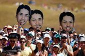 Fans of Jason Day watch the play on the first tee during the final round of the 115th US Open Championship at Chambers Bay on June 21 2015 in...