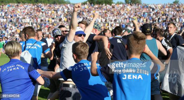 Fans of Jena celebrate the rise up on the place during the Third League Playoff Leg Two between FC Carl Zeiss Jena and Viktoria Koeln on June 01 2017...