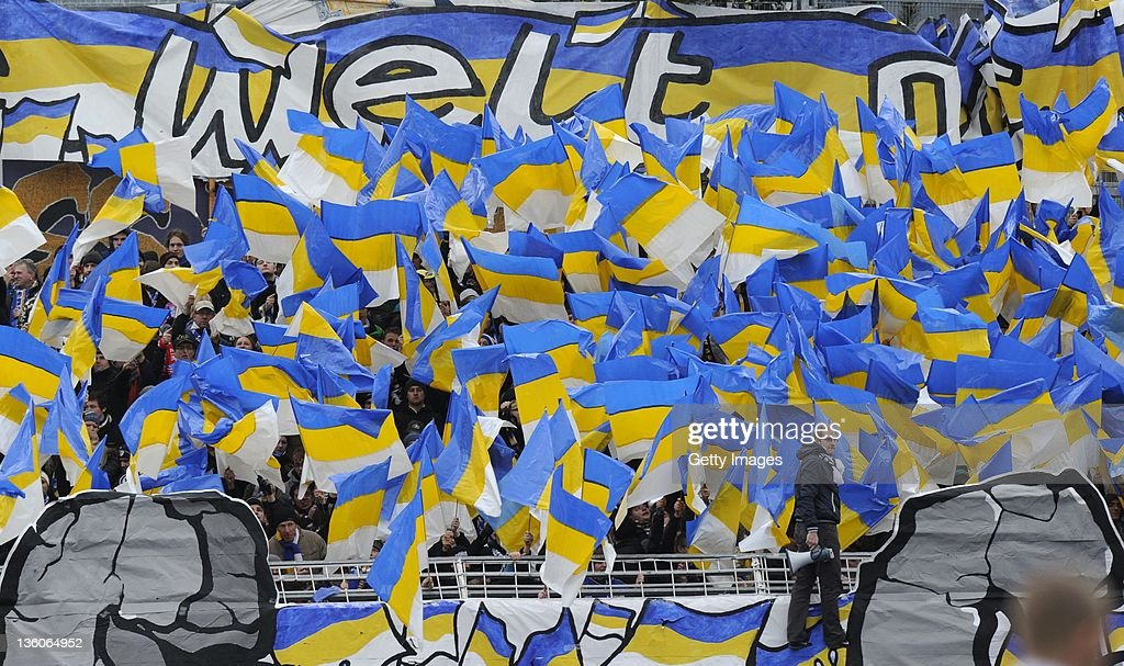 Fans of Jena cheer during the Third League match between Carl Zeiss Jena and RotWeiss Erfurt at Ernst Abbe Sportfeld on December 17 2011 in Jena...