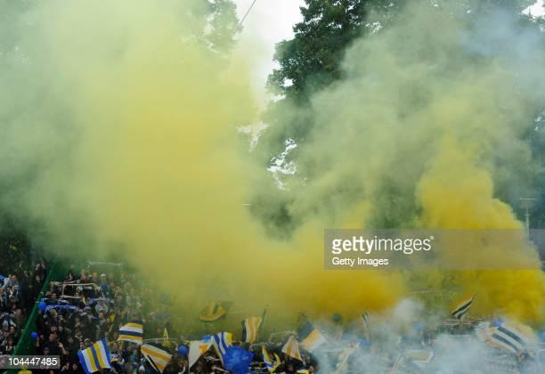 Fans of Jena kindle a firecracker before the Third League match between Rot Weiss Erfurt and Carl Zeiss Jena at Steigerwald Stadium on September 25...