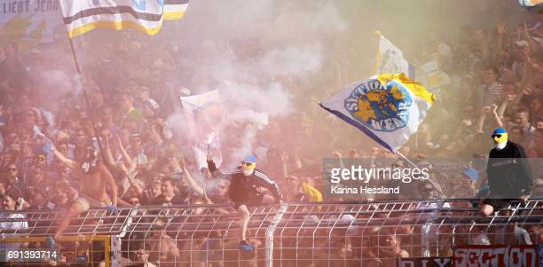 Fans of Jena with Pyrotechnics during the Third League Playoff Leg Two between FC Carl Zeiss Jena and Viktoria Koeln on June 01 2017 at...