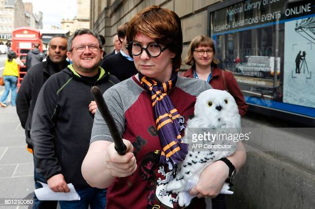 Fans of JK Rowling's Harry Potter books queue outside the The National Library of Scotland in Edinburgh Scotland on June 26 to view a rare first...
