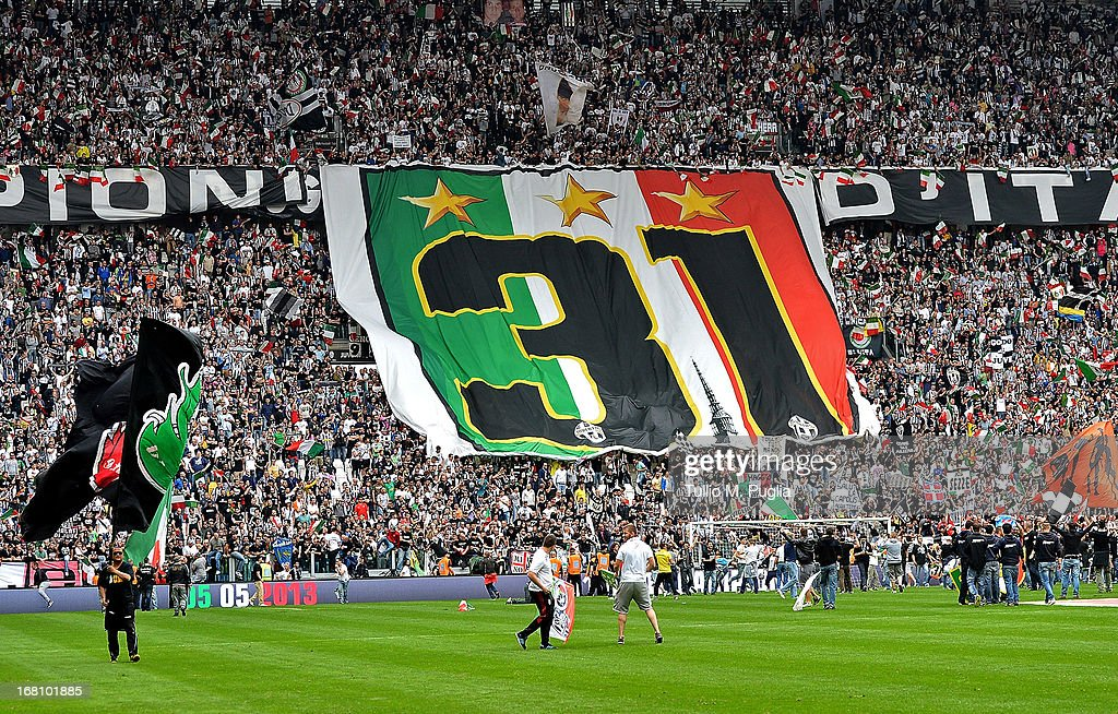 Fans of Juventus celebrate on the pitch after winning the Serie A Championship at the end of the Serie A match between Juventus and US Citta di Palermo at Juventus Arena on May 5, 2013 in Turin, Italy.