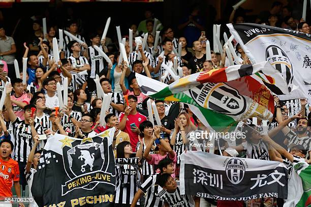 Fans of Juventus cheer after Lorenzo Rossetti scored a goal during the match between Juventus FC and South China of Hong Kong at Hong Kong Stadium on...