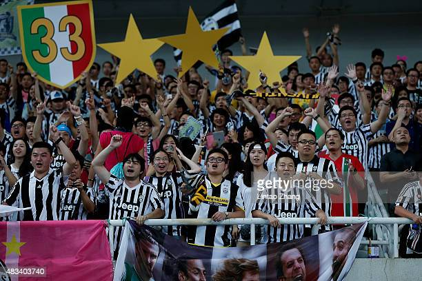 fans of Juventus support their team during the Italian Super Cup final football match between Juventus and Lazio at Shanghai Stadium on August 8 2015...