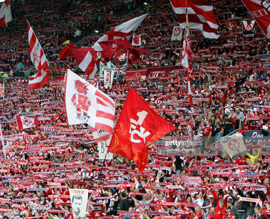 Fans of Kaiserslautern celebrate after winning the match during the Second Bundesliga match between 1FC Kaiserslautern and 1FC Nuernberg at the...