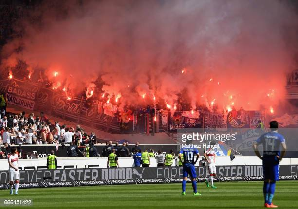 Fans of Karlsruhe burn flares during the Second Bundesliga match between VfB Stuttgart and Karlsruher SC at MercedesBenz Arena on April 9 2017 in...