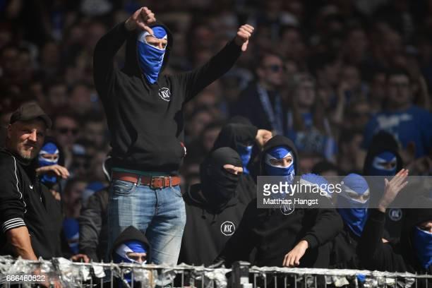 Fans of Karlsruhe react after the Second Bundesliga match between VfB Stuttgart and Karlsruher SC at MercedesBenz Arena on April 9 2017 in Stuttgart...