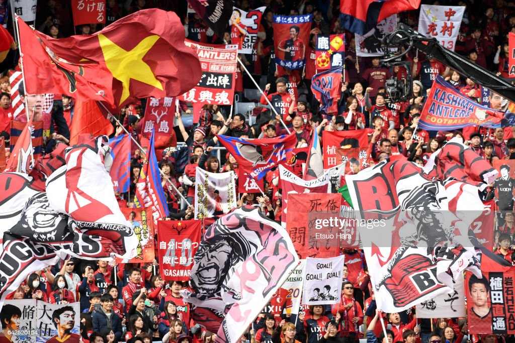 Fans of Kashima Antlers cheer during the Xerox Super Cup match between Kashima Antlers and Urawa Red Diamonds at Nissan Stadium on February 18, 2017 in Yokohama, Kanagawa, Japan.