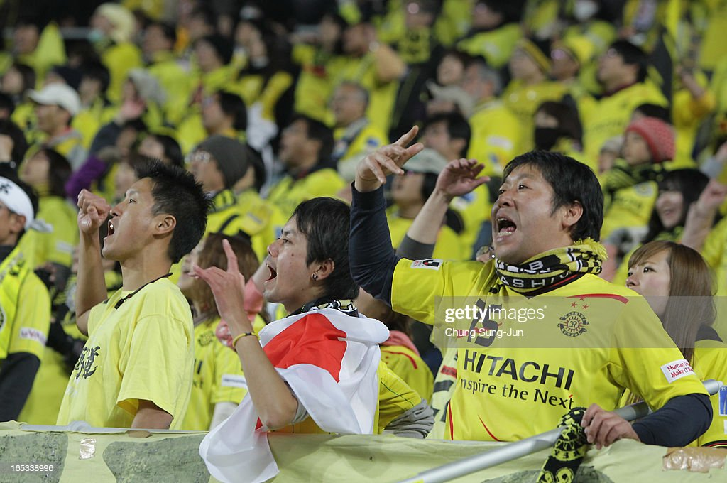 Fans of Kashiwa Reysol cheer during the AFC Champions League Group H match between Suwon Bluewings and Kashiwa Reysol at Suwon World Cup Stadium on April 3, 2013 in Suwon, South Korea.