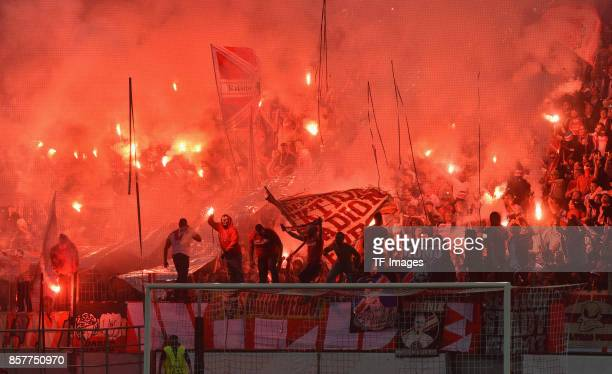 Fans of Koeln fire up bengalo / pyro / firework during the UEFA Europa League group H match between 1 FC Koeln and Crvena Zvezda at...