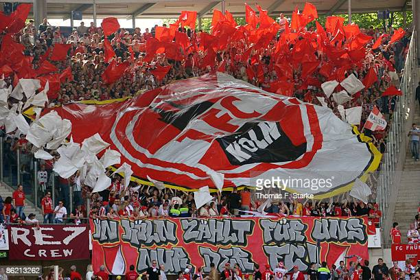 Fans of Koeln show a choreographie prior the Bundesliga match between Hannover 96 and 1FC Koeln at the AWD Arena on April 25 2009 in Hanover Germany
