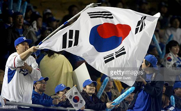 Fans of Korea cheer for the team during the semifinal game of the 2009 World Baseball Classic against Venezuela on March 21 2009 at Dodger Stadium in...