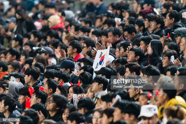 Fans of Korea Republic wave a South Korean flag during their 2018 FIFA World Cup Russia Final Qualification Round Group A match between Korea...