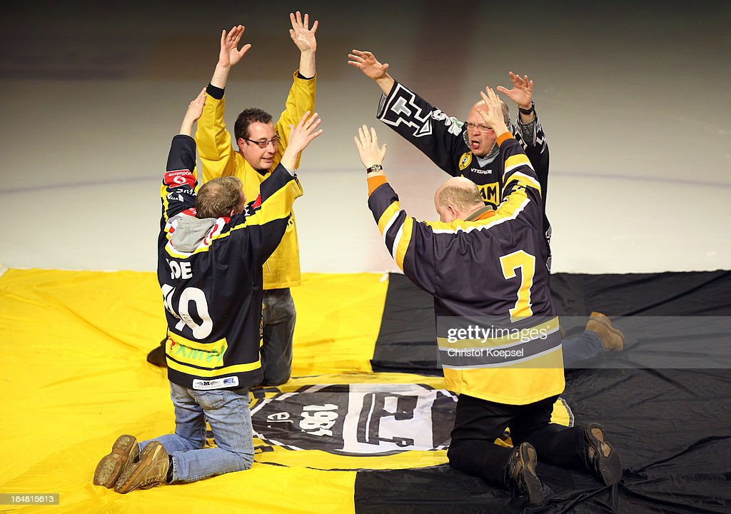 Fans of Krefeld Pinguine pray to win prior to the fifth DEL Play-Off-match between Krefeld Pinguine and ERC Ingolstadt at Koenigspalast on March 28, 2013 in Wuppertal, Germany.
