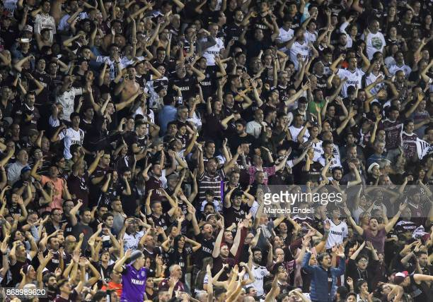 Fans of Lanus cheer for their team after winning a second leg match between Lanus and River Plate as part of the semifinals of Copa CONMEBOL...