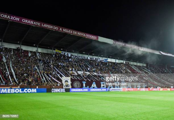 Fans of Lanus cheer for their team prior a second leg match between Lanus and River Plate as part of the semifinals of Copa CONMEBOL Libertadores...