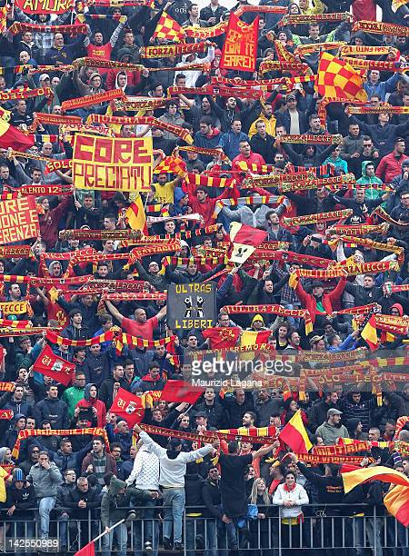 Fans of Lecce show their support during the Serie A match between US Lecce and AS Roma at Stadio Via del Mare on April 7 2012 in Lecce Italy