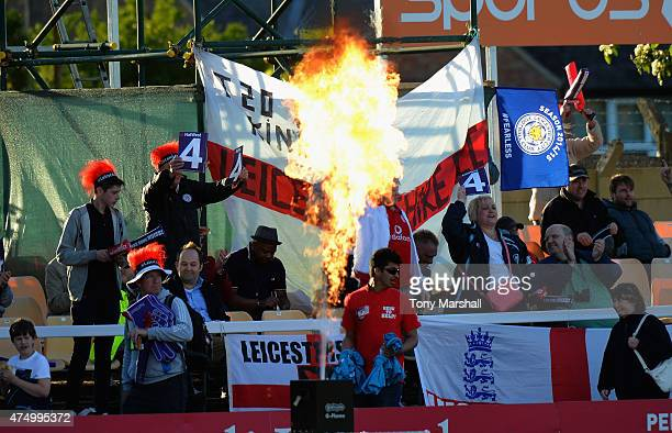 Fans of Leicestershire Foxes celebrate a four during the NatWest T20 Blast match between Leicestershire Foxes and Durham Jets at Grace Road on May 28...
