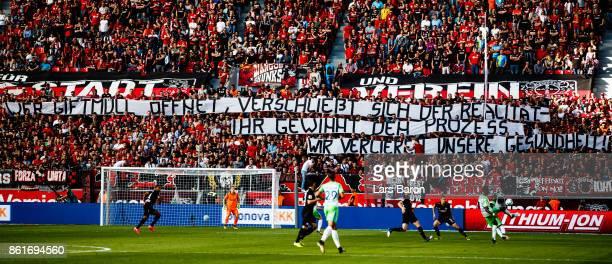 Fans of Leverkusen are seen during the Bundesliga match between Bayer 04 Leverkusen and VfL Wolfsburg at BayArena on October 15 2017 in Leverkusen...