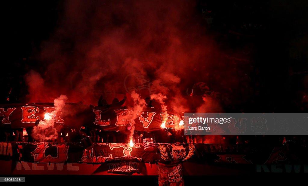 Fans of Leverkusen burn flares during the Bundesliga match between 1. FC Koeln and Bayer 04 Leverkusen at RheinEnergieStadion on December 21, 2016 in Cologne, Germany.