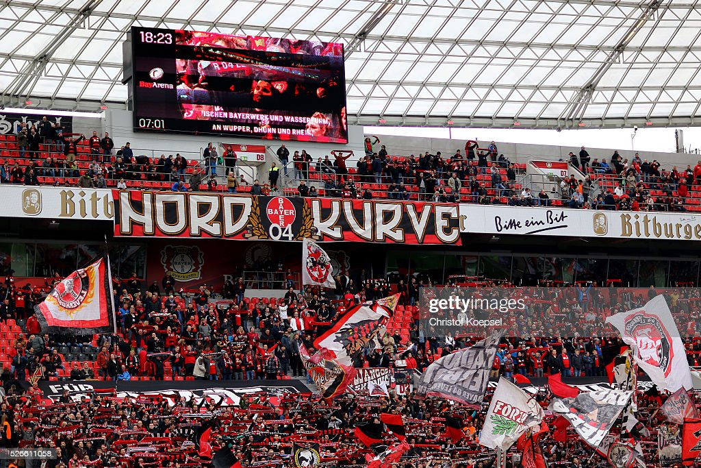 Fans of Leverkusen celebrate during the Bundesliga match between Bayer Leverkusen and Hertha BSC Berlin at BayArena on April 30, 2016 in Leverkusen, Germany. The match between Leverkusen and Berlin ended 2-1.