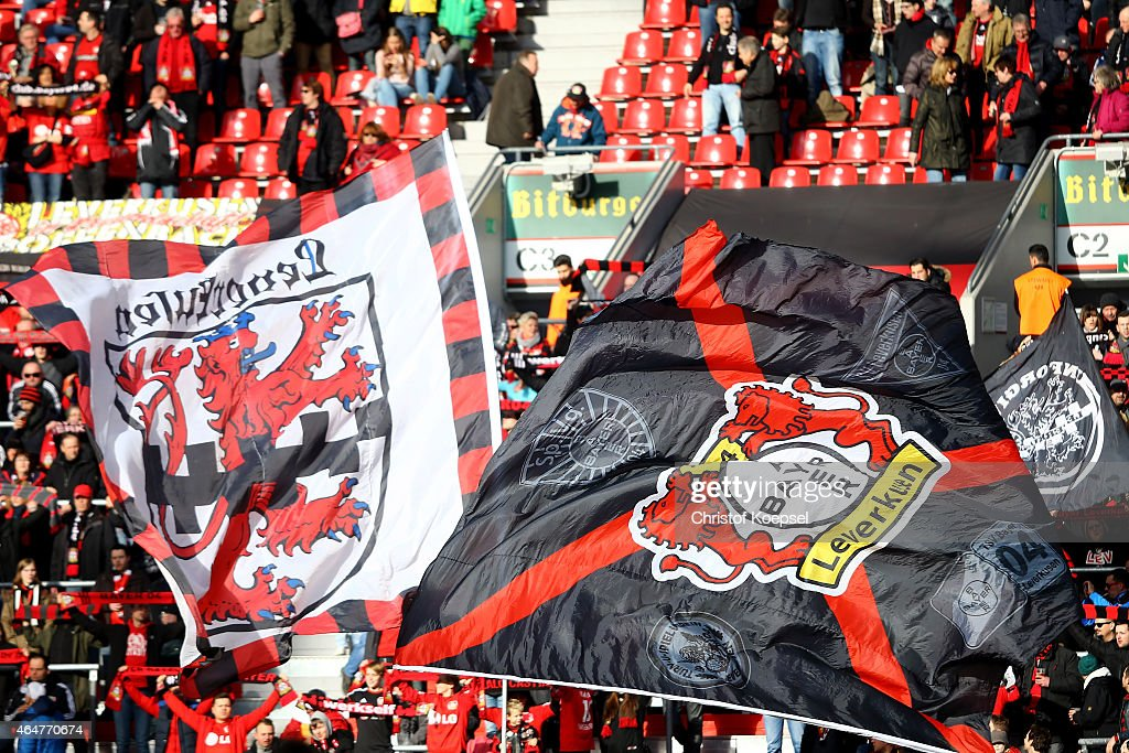 Fans of Leverkusen wave flags during the Bundesliga match between Bayer 04 Leverkusen and SC Freiburg at BayArena on February 28, 2015 in Leverkusen, Germany.