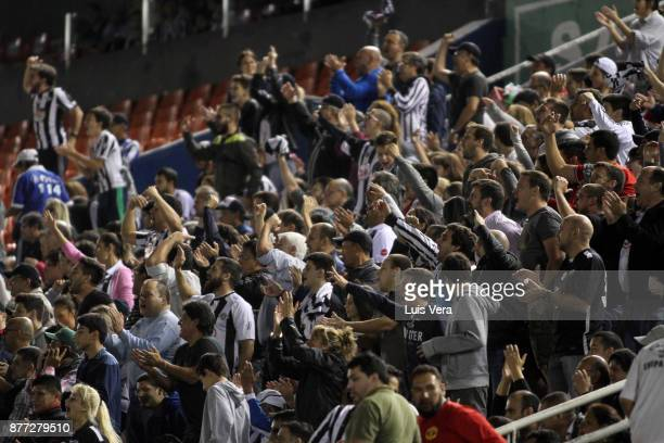 Fans of Libertad cheer for their team during a first leg match between Libertad and Independiente as part of the semifinals of Copa CONMEBOL...
