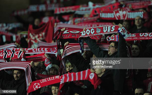 Fans of Lille show there colours during the Ligue 1 match between LOSC Lille Metropole v FC Girondins de Bordeaux at the Grand Stade LilleMetropole...