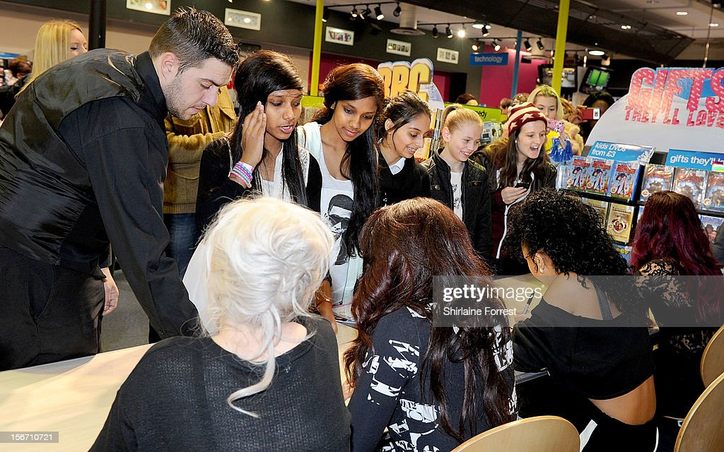 Fans of Little Mix meet the band signing copies of their album 'DNA' on November 19, 2012 in Birmingham, England.