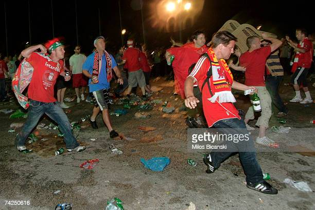 Fans of Liverpool and AC Milan fight in the streets during the UEFA Champions League Final match on May 23 2007 in Athens Greece