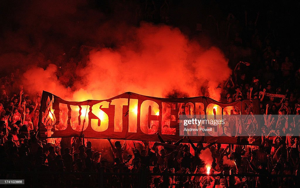 Fans of Liverpool hold up a banner that reads 'Justice for the 96' during the Pre Season match between Indonesia XI and Liverpool at Gelora Bug Karno stadium on July 20, 2013 in Jakarta, Indonesia.
