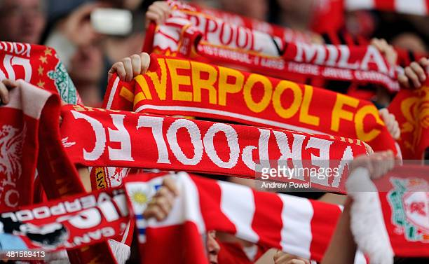 Fans of Liverpool hold up scarves during the Barclays Premier League match between Liverpool and Tottenham Hotspur at Anfield on March 30 2014 in...