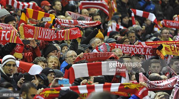 Fans of Liverpool wave scarves before the Barclays Premier League match between Liverpool and Tottenham Hotspur at Anfield on February 10 2015 in...