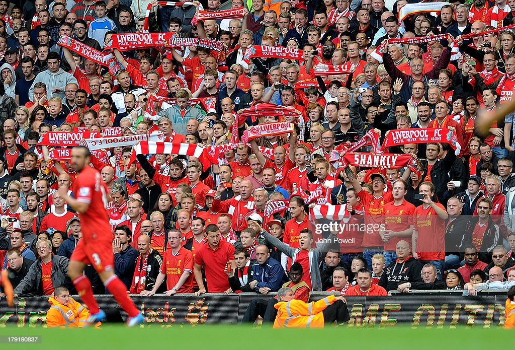 Fans of Liverpool waving flags during the Barclays Premier League match between Liverpool and Manchester United at Anfield on September 01, 2013 in Liverpool, England.