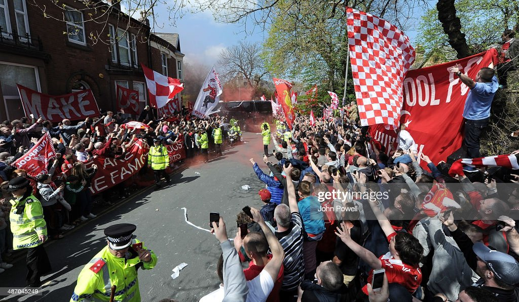 Fans of Liverpool welcome the team coach as it arrives prior the Barclays Premier League match between Liverpool and Chelsea at Anfield on April 27, 2014 in Liverpool, England.