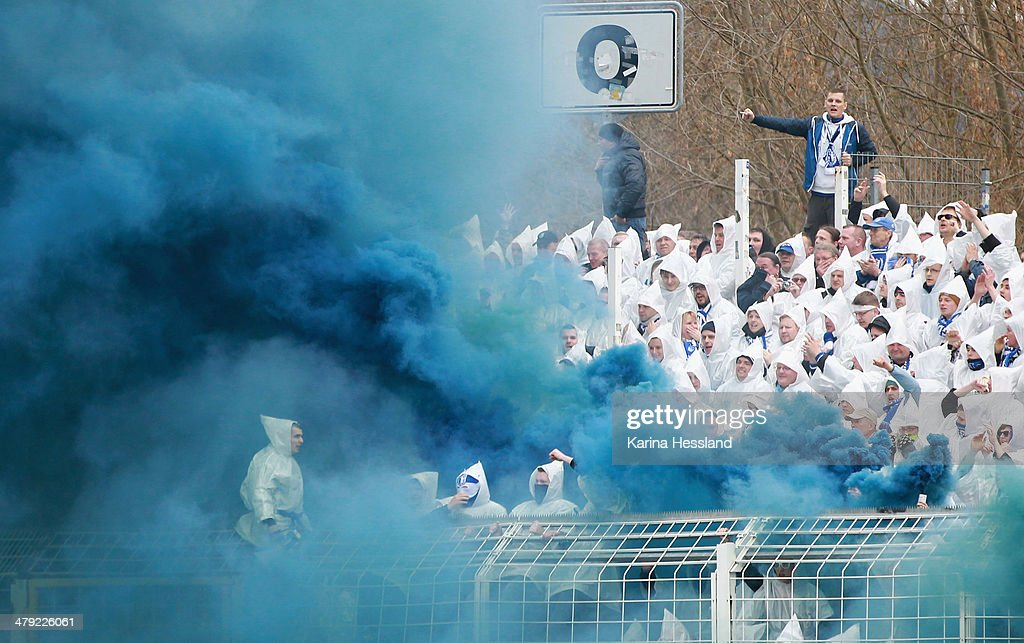 Fans of Magdeburg in blue fog during the Regionalliga match between FC Carl Zeiss Jena and 1.FC Magdeburg at Ernst Abbe Sportfeld on March 16, 2014 in Jena, Germany.