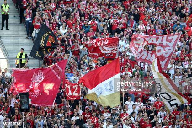 Fans of Mainz celebrate during the Bundesliga match between 1 FSV Mainz 05 and Hamburger SV at Opel Arena on October 14 2017 in Mainz Germany